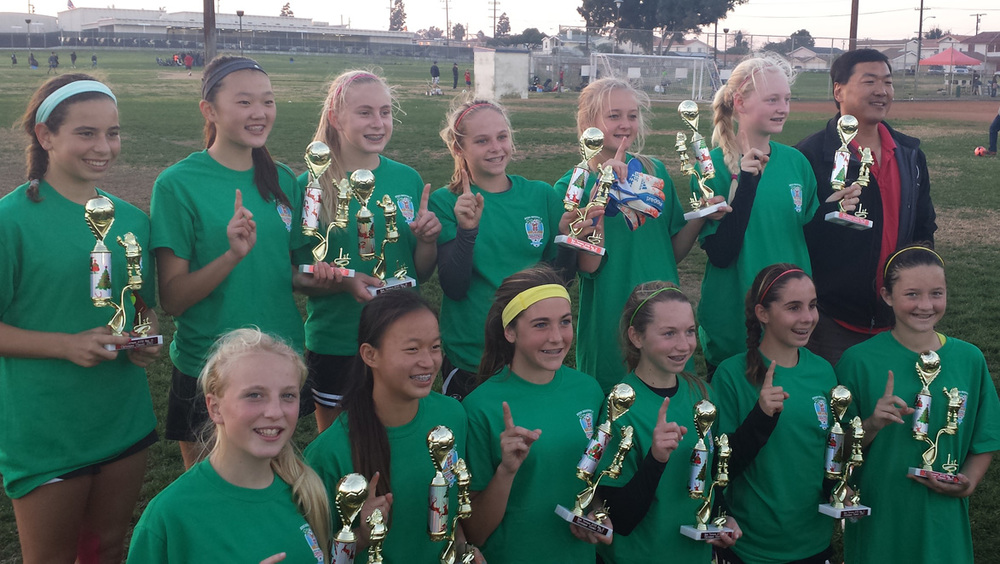 The GU14 Manhattans won the 2013 Torrance Christmas Classic soccer tournament with a record of 4-0, outscoring their opponents 20-2.  Back (l to r) Jamie Averch, Juliana Chen, Michelle Drandell, Shannon Blood, Sarah Lastition, Katharine Rogerson.  Front (l to r) Sydney Whitcombe, Kelli Toyooka, Kendal Rohm, Megan Fisher, Camille Petroni, Cami Benson.  Not pictured, Kelli Barry.  Coach, Albert Chen.