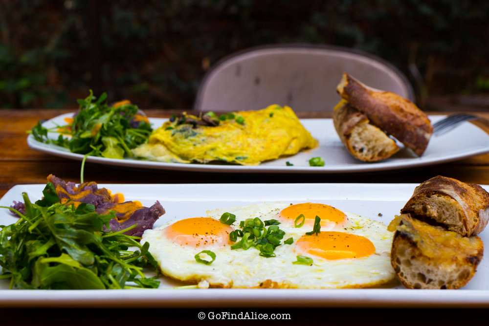 The Sunny Side ($9)  - 3 sunny side up eggs in olive oil, served with arugula salad, sweet potato, with baguette and housemade butter/jam