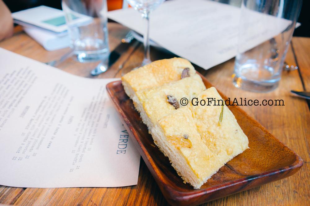 Complimentary olive focaccia bread at Locanda Verde