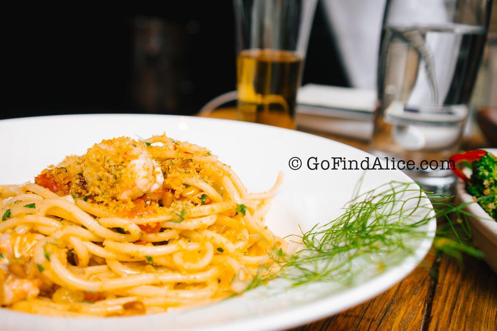 Locanda Verde's homemade Bucatini pasta with rock shrimp, calamari & cherry tomatoes