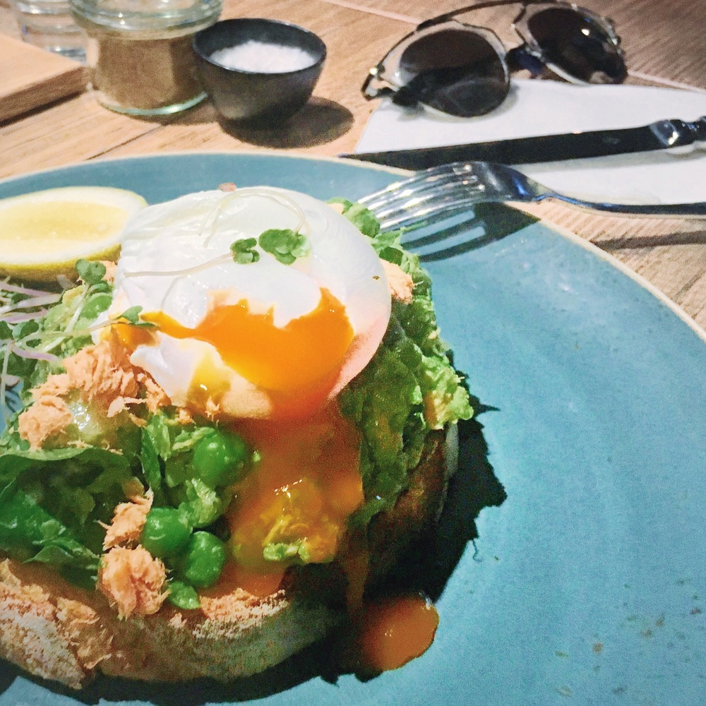 Smashed peas and trout toast  topped with a poached egg.
