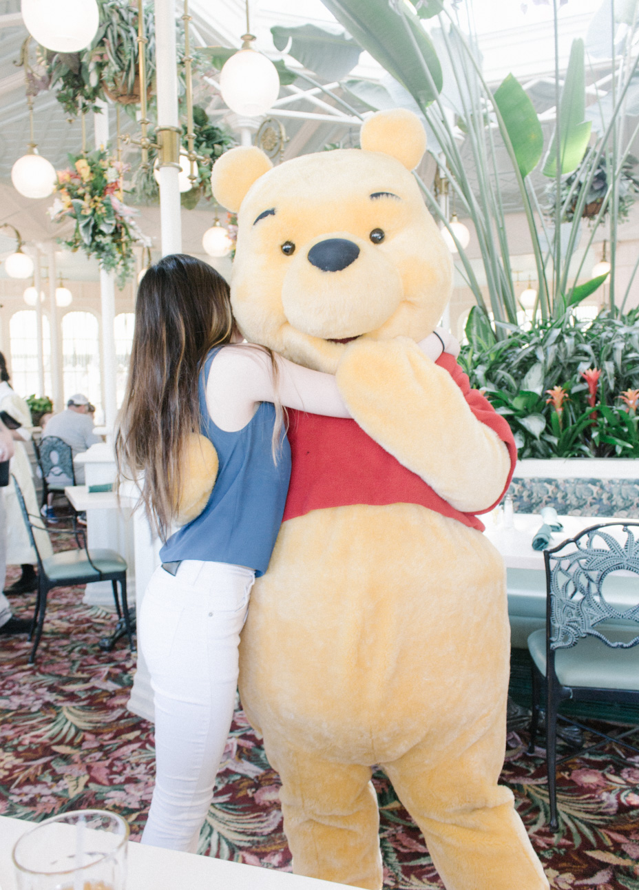 Big huggie with Pooh at the Crystal Palace while buffet feasting x