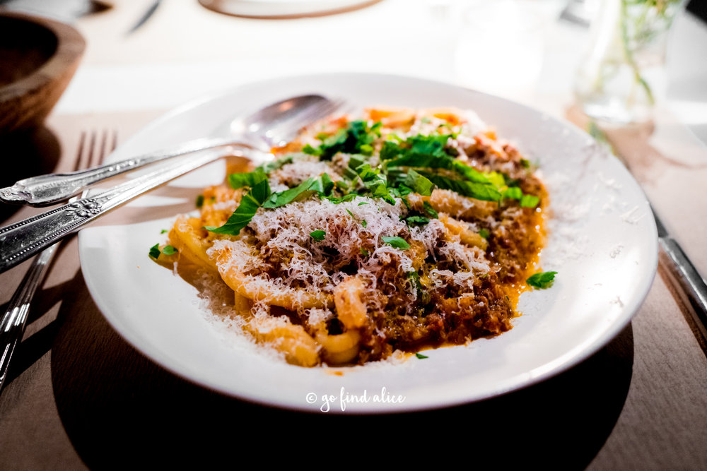 Strozzapreti with spicy bolognese and herbs ($29)