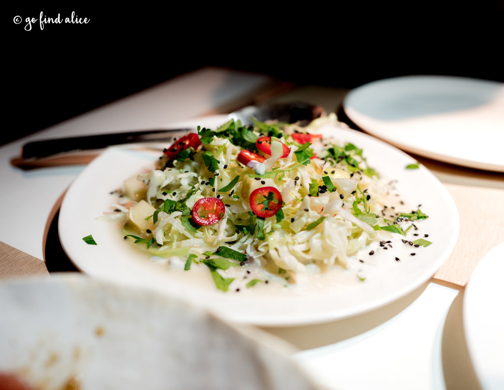 Cabbage & Apple Salad, Cashew Yogurt and Herbs ($16)