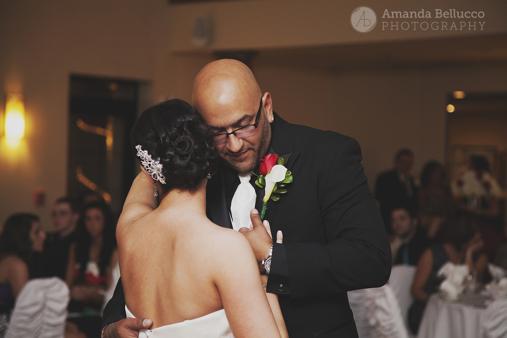 The bride and groom have their first dance together at the Italian American Community Center.