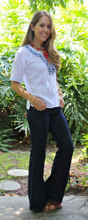 Flared jeans with embroidered top