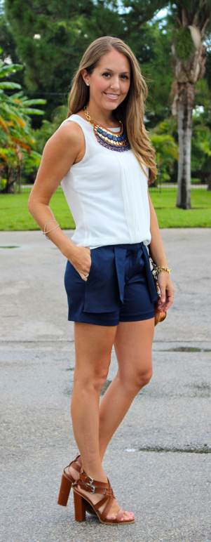 Navy shorts with basic top and bib necklace