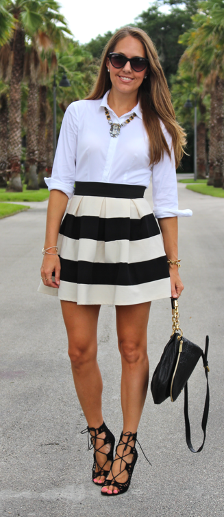 White button front shirt with wide stripe skirt