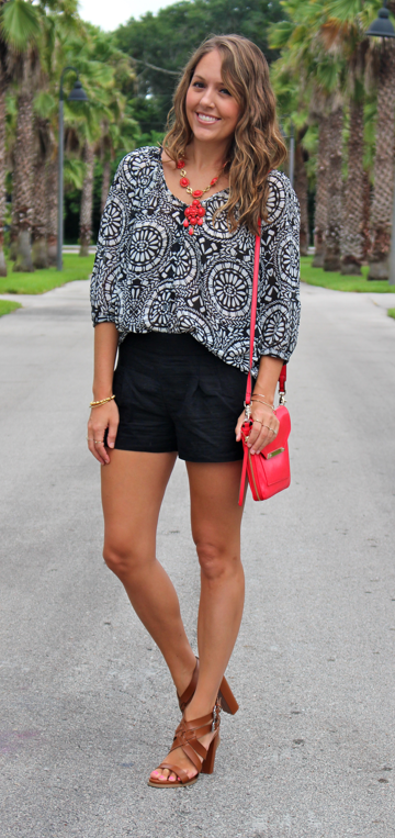 Black and white print top with red accents