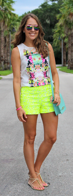 Mirror print top with neon shorts and mint purse