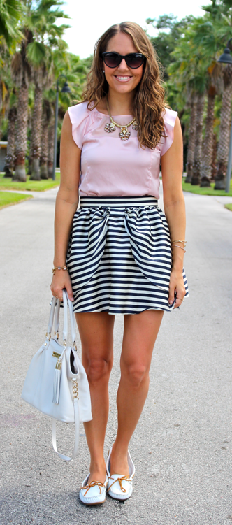 Blush pink top with H&M striped skirt and white boat mocs