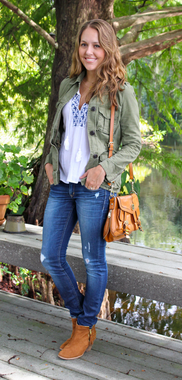 Military jacket with embroidered blouse and cognac accessories