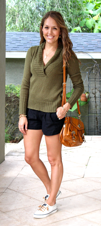 Olive sweater with black shorts
