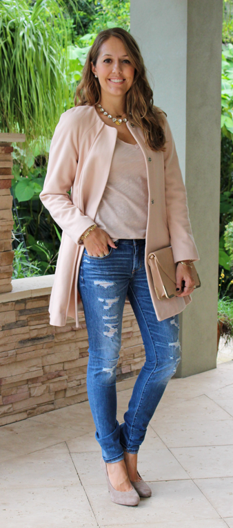 Pink ASOS coat with distressed jeans