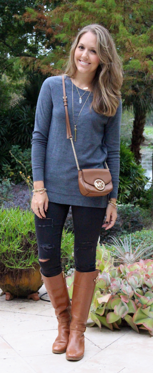 Gray sweater, black jeans and cognac riding boots
