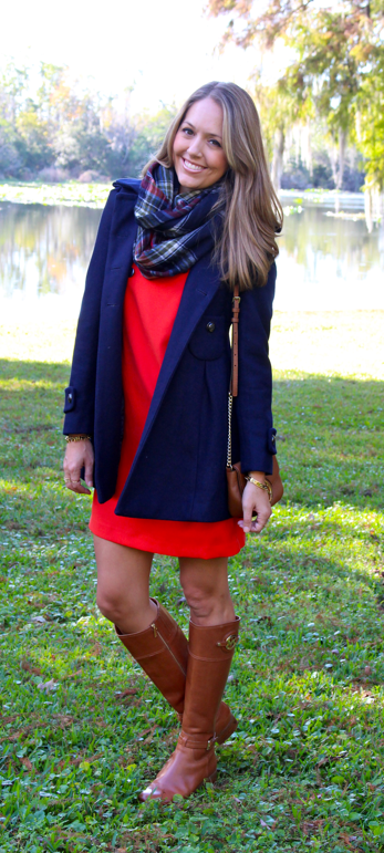Navy coat, red dress, plaid scarf