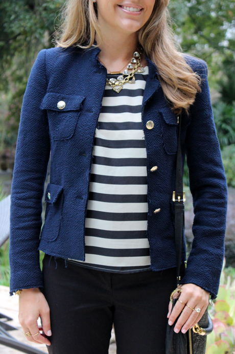 Navy boucle jacket, wide stripe blouse, layered necklaces
