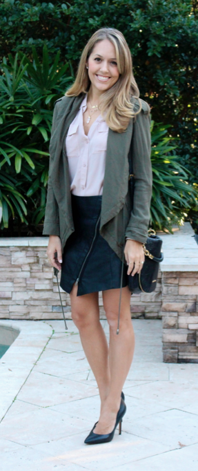 Army green jacket, blush top, faux leather skirt