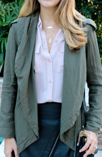 Army green jacket, blush silk top, faux leather skirt