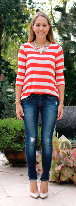 Candy cane striped shirt, statement necklace, jeans