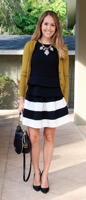 Pea green cardigan, black peplum top, wide stripe skirt