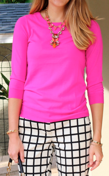 Layered statement necklaces, pink sweater, grid print