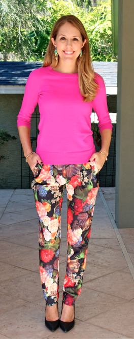 Pink sweater, statement earrings, floral pants