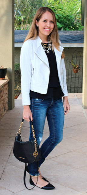 White motorcycle jacket, black top, jeans