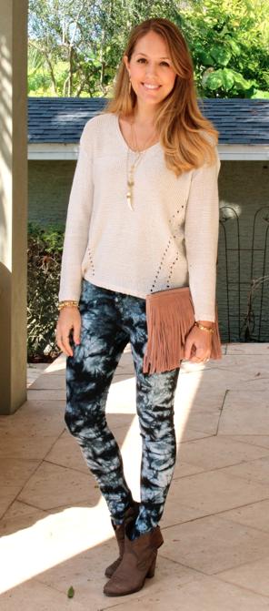 Ivory sweater, tie dye jeans, fringe clutch