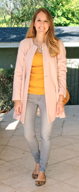 Pink coat, yellow sweater, gray jeans, leopard flats