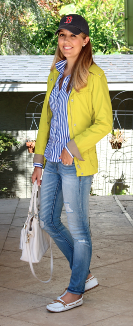 Yellow rain jacket, striped top