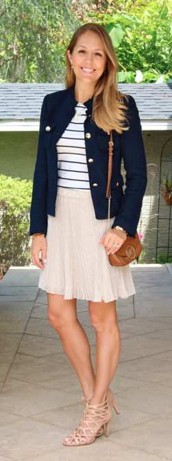 Navy boucle jacket, striped shirt, pleated skirt