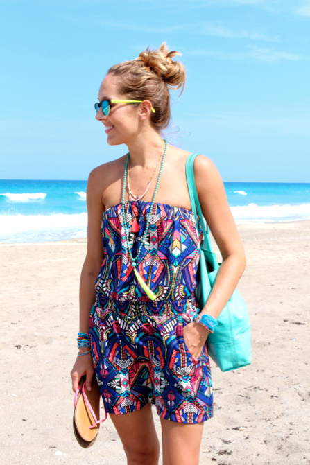 Printed romper with tassel necklaces