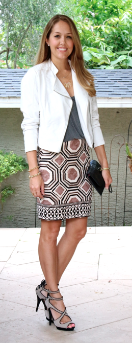 White motorcycle jacket, geometric print skirt