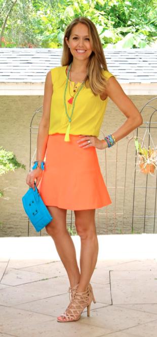 Yellow top, orange skirt, blue clutch