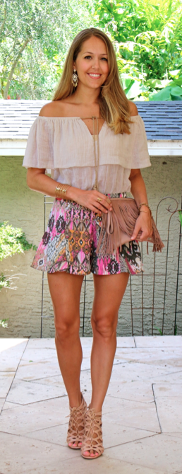 Off-shoulder top with printed shorts and fringe clutch