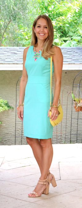 Mint sheath with yellow purse and colorful necklace