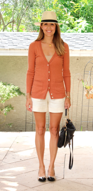 Pumpkin sweater, ivory shorts, Panama hat