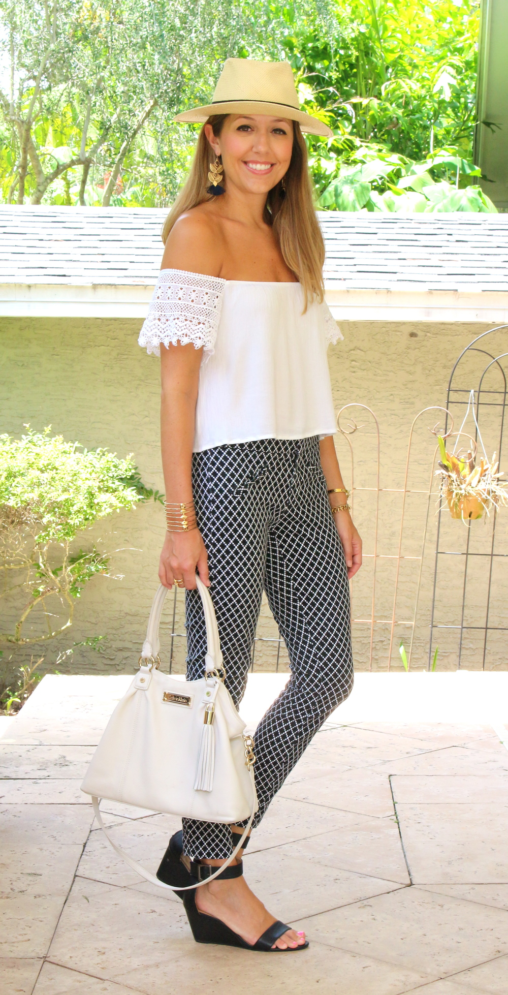 White off shoulder top with printed pants