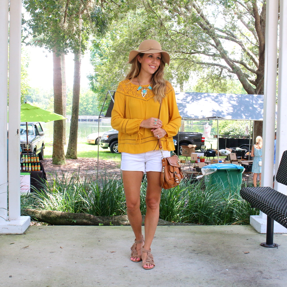 Mustard top, turquoise necklace, white shorts