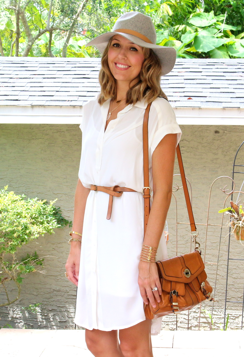 White shirt dress with gray hat and cognac accessories