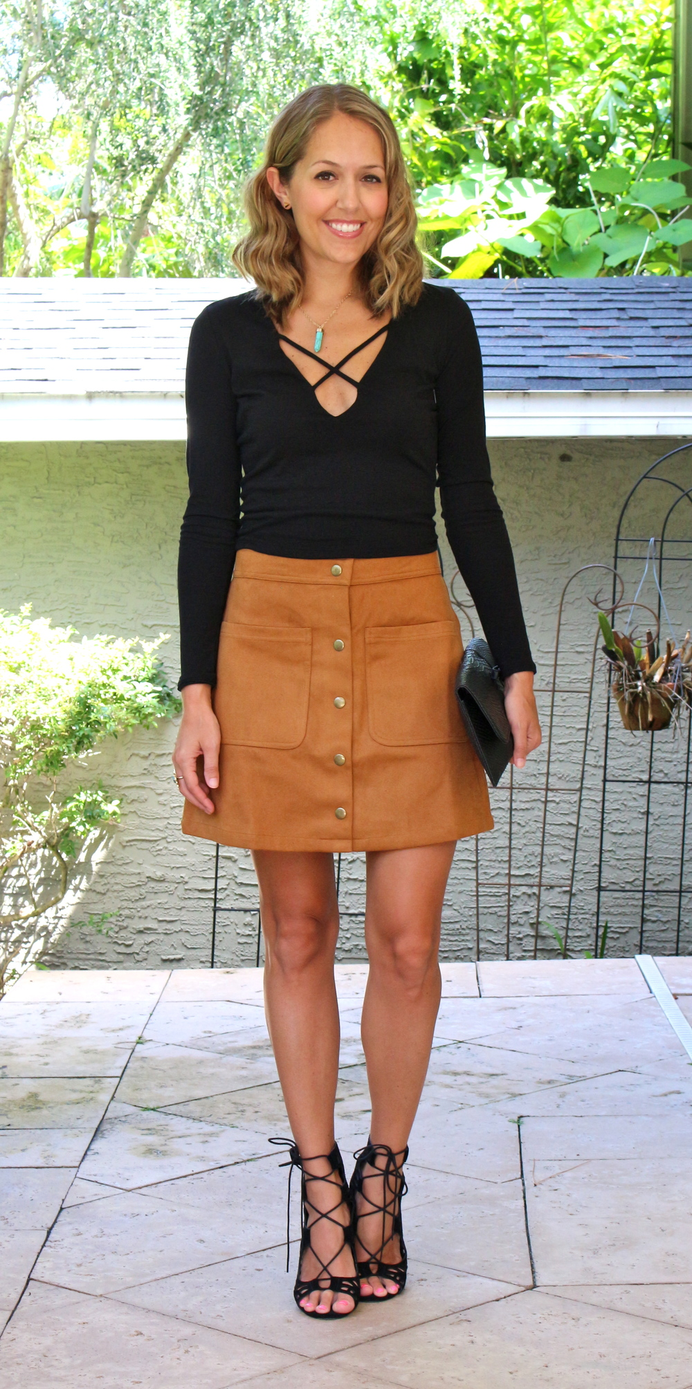 Criss cross top $10 and suede skirt $33