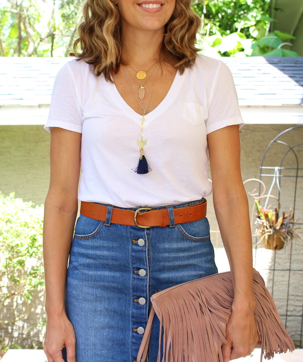 White tee, denim skirt, fringe clutch
