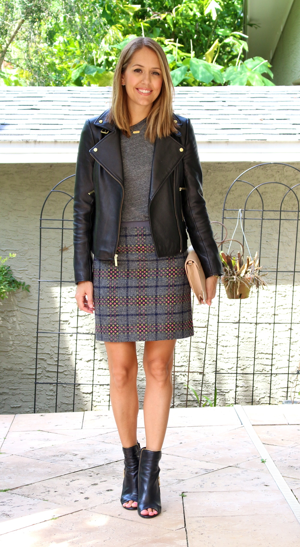 Leather jacket, gray tee, plaid skirt