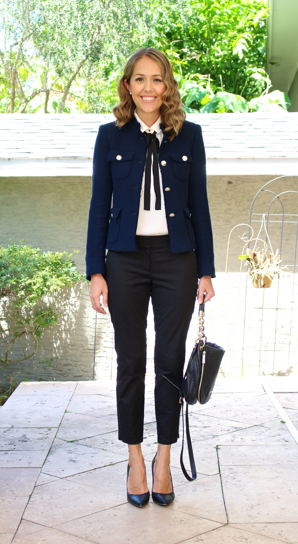 Navy boucle jacket, black trousers, tie front blouse