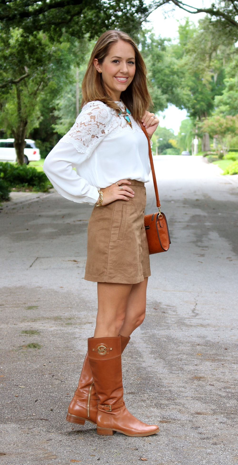 Lace top, suede skirt, riding boots