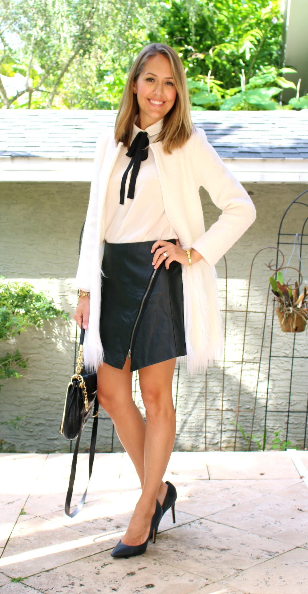 Faux fur coat, tie neck blouse, leather zip skirt