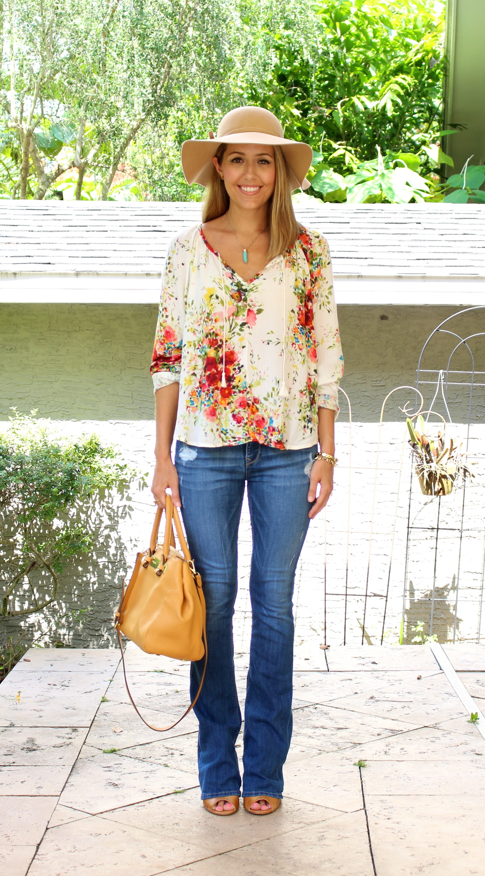 Boho floral blouse, flare jeans, wool hat