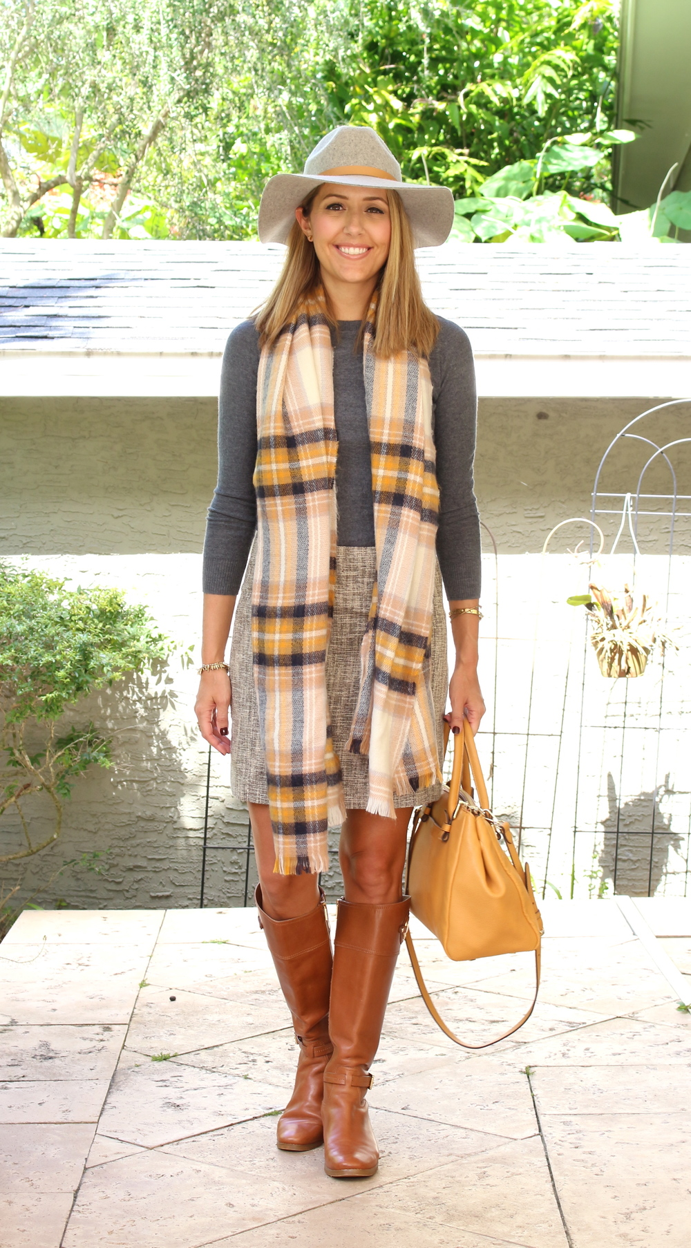 Gray sweater, tweed skirt, plaid scarf, wool hat