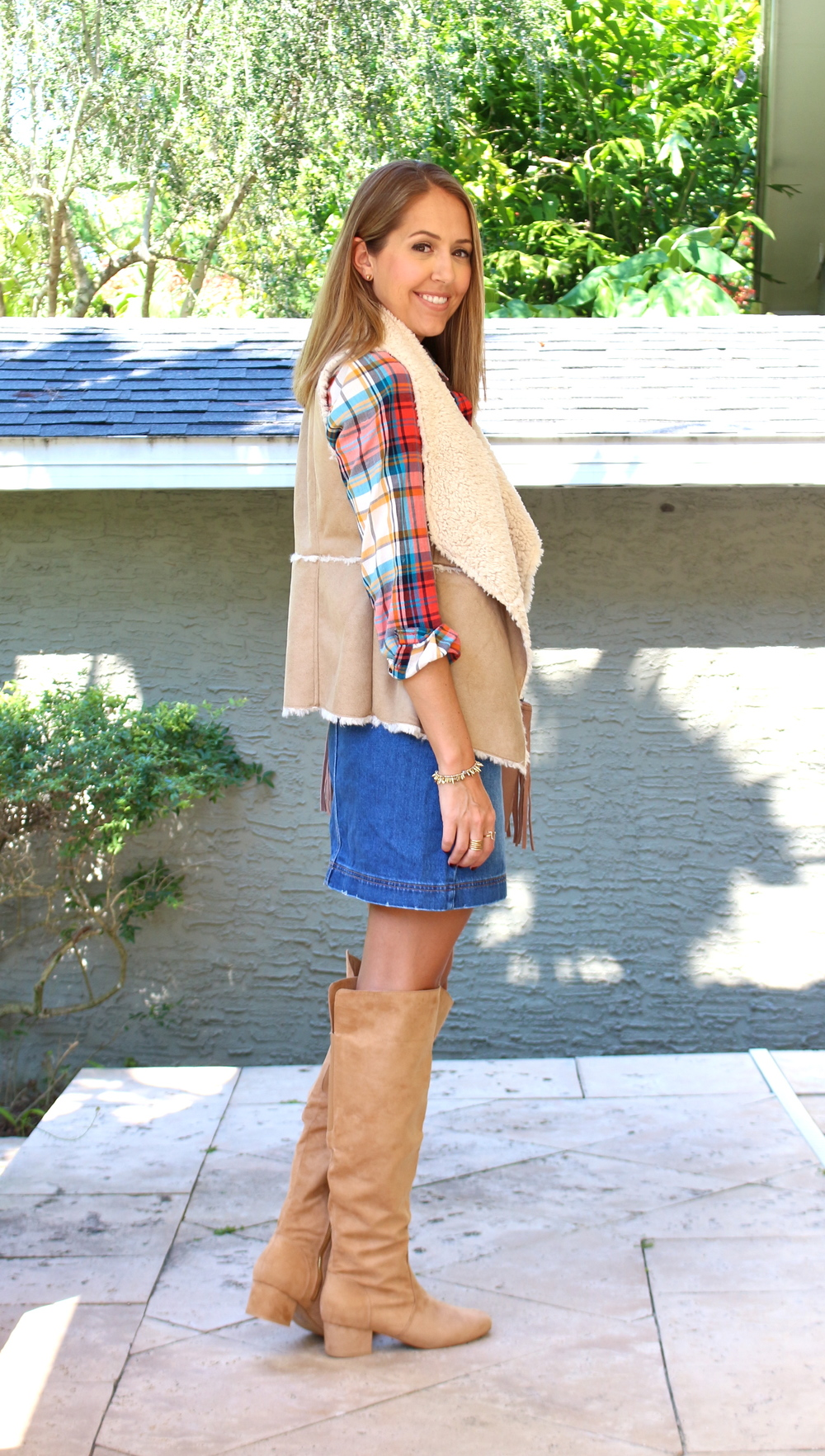 Shearling vest, denim skirt, suede boots